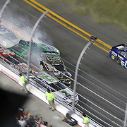 NASCAR Sprint Cup driver Danica Patrick (10) and Kyle Busch (18) wreck prior to the finish line during the NASCAR Coke Zero 400 Sprint series auto race at the Daytona International Speedway on Saturday, July 6, 2013 in Daytona Beach, Florida.  (AP Photo/Alex Menendez)