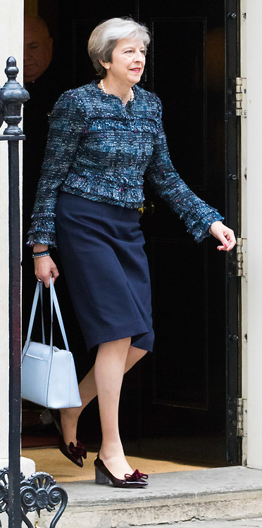 Downing Street, London, May 3rd 2017. British Prime Minister Theresa May leaves 10 Downing Street to visit the Queen at Buckingham Palace to seek her permission to dissolve Parliament ahead of the general election scheduled for June 8th.