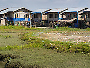 11 NOVEMBER 2014 - SITTWE, MYANMAR: About 700 Rakhine Buddhist families live in an Internal Displaced Persons (IDP) camp on the edge of Sittwe. The people in the camp lost their homes in Sittwe in 2012 when Buddhist mobs rioted and burnt down Rohingya Muslim homes and businesses. The Buddhists' homes were mistakenly destroyed by other Buddhists or intentionally destroyed by retaliating Muslims during the 2012 violence. Unlike the Muslims, who live in much larger camps further from Sittwe, the Buddhists are allowed to come and go into downtown Sittwe and their homes are built in the traditional style, on stilts with large windows, and so are much more comfortable.   PHOTO BY JACK KURTZ