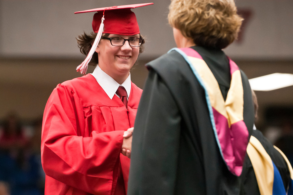 Lathan Goumas | MLive.com..A graduate walks across the stage during the 2012 Swartz Creek High School commencement ceremony at the Perani Arena in Flint, Mich. on Tuesday June 12, 2012.