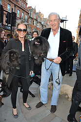 MARTIN & ANNE SUMMERS and their dogs Coco & Sushi at The Dog's Trust Awards announcement held at George, 87-88 Mount Street, London on 27th March 2012.