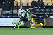 Curtis Thompson of Notts County tussles with Andy Barcham of AFC Wimbledon during the Sky Bet League 2 match between Notts County and AFC Wimbledon at Meadow Lane, Nottingham, England on 23 January 2016. Photo by Stuart Butcher.