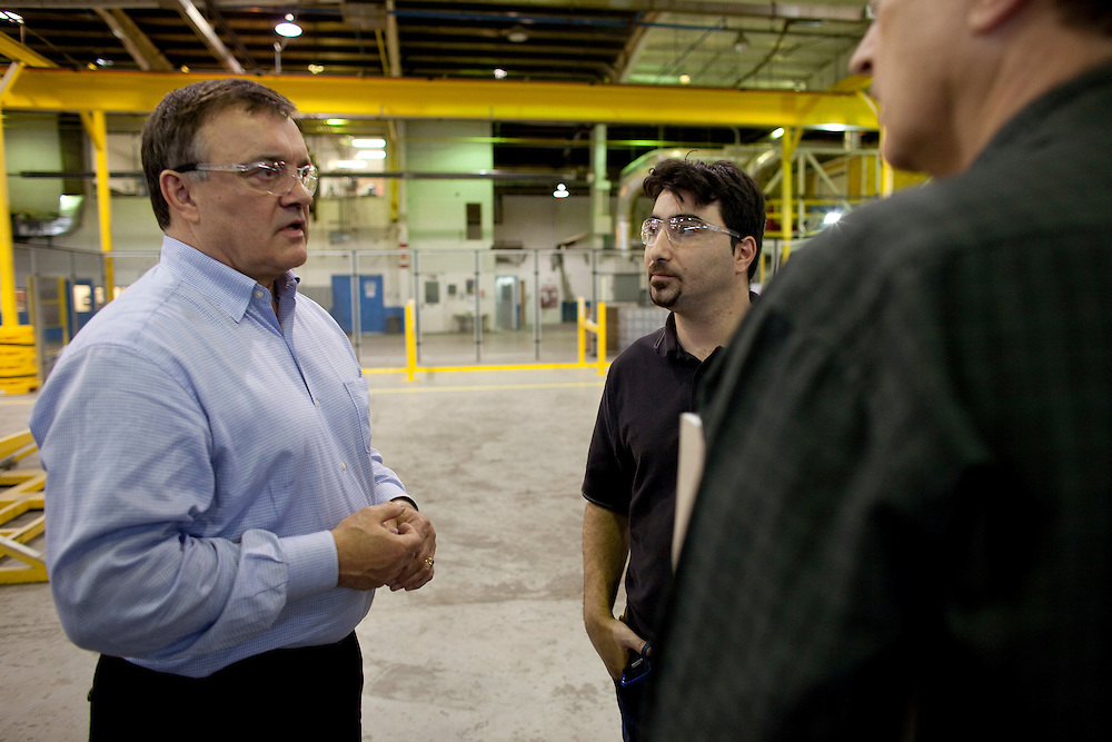 Tilbury, Ontario ---10-01-06--- Paul Giannelia, CEO of RS Technologies talks with colleagues at the company's manufacturing plant in Tilbury, Ontario where they are producing their composite utility poles. <br /> GEOFF ROBINS The Globe and Mail