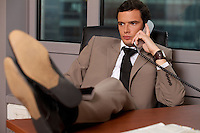 Businessman talking on telephone in an office