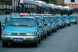 CHINA SHANGHAI NOV01 - A row of waiting Volkswagen Santana taxis, manufactured in a Shanghai joint-venture with the German car manufacturer.. . . jre/Photo by Jiri Rezac. . © Jiri Rezac 2001. . Contact: +44 (0) 7050 110 417. Mobile:  +44 (0) 7801 337 683. Office:  +44 (0) 20 8968 9635. . Email:   jiri@jirirezac.com. Web:     www.jirirezac.com