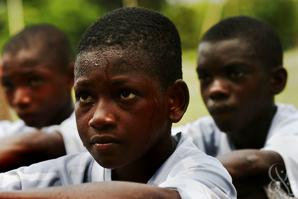 Teenage Ivorian football players listen to coaches during halftime of a test match at the ASEC football academy February 18, 2006 in Abidjan, Côte d'Ivoire. ASEC academy has an established history of producing top notch footballers who go on to play in the top European football leagues.