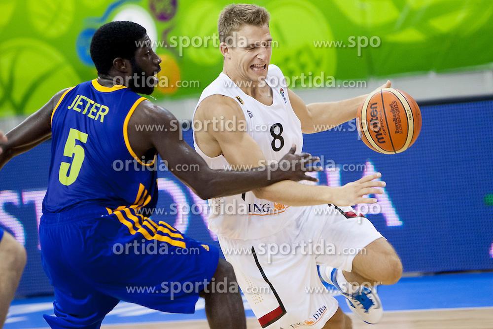 Eugene Jeter #5 of Ukraine and Heiko Schaffartzik #8 of Germany during basketball match between National teams of Germany and Ukraine at Day 3 of Eurobasket 2013 on September 6, 2013 in Tivoli Hall, Ljubljana, Slovenia. (Photo By Urban Urbanc / Sportida )