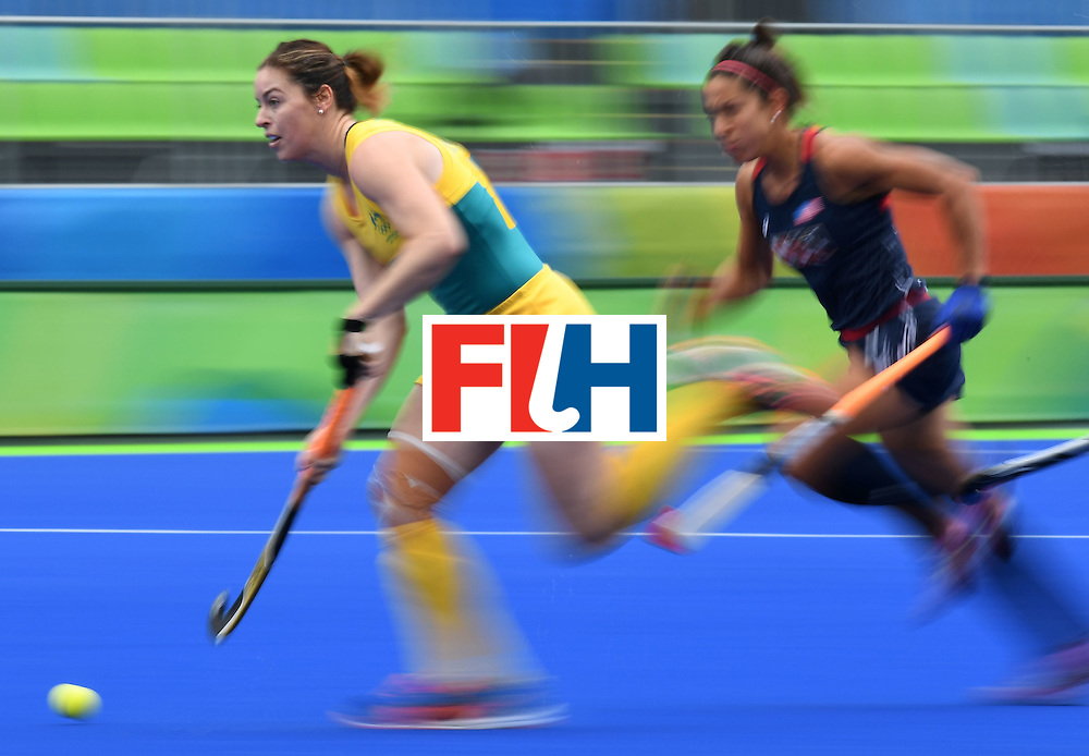 Australia's Karri McMahon (L) controls the ball as the USA's Melissa Gonzalez chases during the womens's field hockey Australia vs USA match of the Rio 2016 Olympics Games at the Olympic Hockey Centre in Rio de Janeiro on August, 8 2016. / AFP / MANAN VATSYAYANA        (Photo credit should read MANAN VATSYAYANA/AFP/Getty Images)