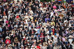 © Licensed to London News Pictures. 19/06/2018. London, UK.  Racegoers in the Royal Enclosure watch members of the Royal Family arrive at day one of Royal Ascot at Ascot racecourse in Berkshire, on June 19, 2018. The 5 day showcase event, which is one of the highlights of the racing calendar, has been held at the famous Berkshire course since 1711 and tradition is a hallmark of the meeting. Top hats and tails remain compulsory in parts of the course. Photo credit: Ben Cawthra/LNP