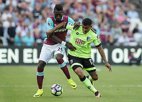 Football - 2016 / 2017 Premier League - West Ham United vs. AFC Bournemouth<br /> <br /> Arthur Masuaku of West Ham and Bournemouth's Joshua King tussle for the ball at The London Stadium.<br /> <br /> COLORSPORT/DANIEL BEARHAM