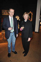 TIM KNOX and FIONA ANNESLEY at a party to celebrate the publication of The irish Country House written by The Knight of Glin and James Peill with photographs by James Fennell, held at Christie's, King Street, London on 24th January 2011.