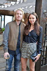 DOMINIC JONES and VICTORIA HATCHER at the Warner Music Group Summer Party in association with British GQ held at Shoreditch House, Ebor Street, London E2 on 8th July 2015.