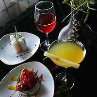 Crystal Chatham/The Desert Sun<br /> <br /> 09/11/2007 -- A sampling of dishes at Bamboo Cove in Palm Desert includes traditional Vietnamese spring rolls (back), their signature salad named the sweet pepper bouquet (front). Drinks include the house red wine and the restaurant's signature bamboo cove martini made from fresh extracted sugar cane juice, vodka, sake, and vermouth.