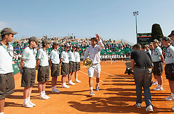 MONTE-CARLO, MONACO - Sunday, April 18, 2010: Rafael Nadal (ESP) walks off court with the trophy after winning the the Men's Singles Final on day seven of the ATP Masters Series Monte-Carlo at the Monte-Carlo Country Club. This was Nadal's sixth straight victory in the tournament, setting a record for the most Masters Series consecutive victories at a single tournament by any player. (Photo by David Rawcliffe/Propaganda)