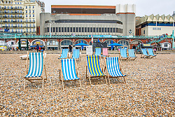 © Licensed to London News Pictures. 26/05/2019. Brighton, UK.  Deckchairs stand unused as only a handful of members of the public can be seen on the beach in Brighton and Hove. Grey moulds and colder weather are hitting the seaside resort on the May Bank holiday Sunday. Photo credit: Hugo Michiels/LNP