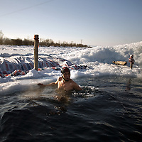 Chinese man swim in the frozen river during the  winter swimming festival held in Harbin, northeastern China's Heilongjiang province, Tuesday, Jan. 6, 2009, Photographer: Bernardo De Niz