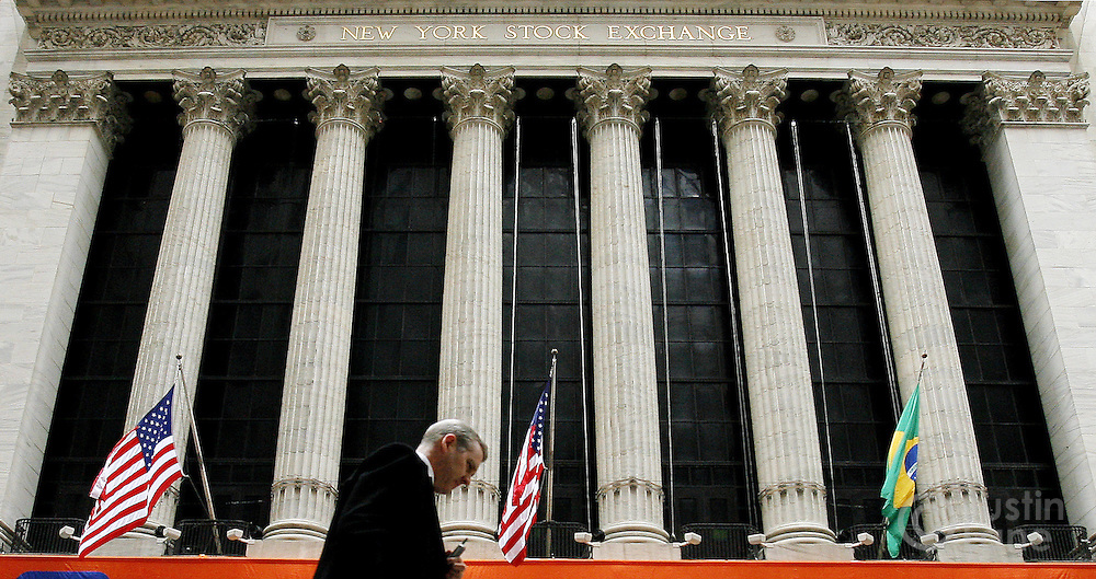 A man walks past the New York Stock Exchange in New York, New York on Thursday 01 March 2007. The Dow Jones industrials ended down 34 points after falling 209 points in early in the day. Earlier in the week the Dow lost 416 points in reaction to financial woes in Asia.