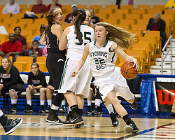 Wyoming East guard Gabby Lupardus (32) drives baseline against Bluefield during a first round game at the Charleston Civic Center.
