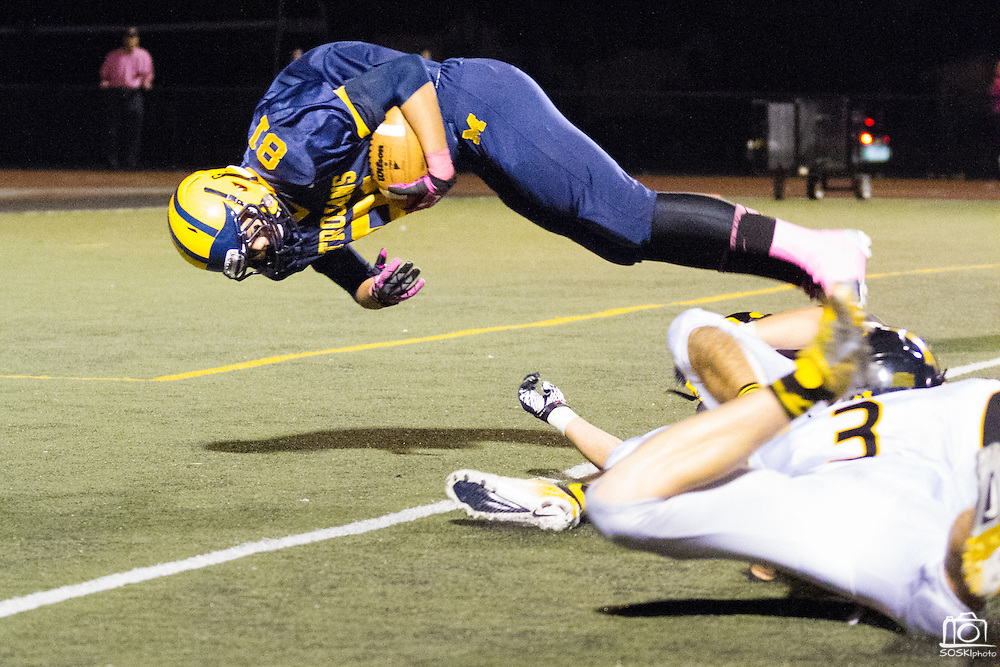Milpitas High School senior, Anthony Chu (81), dives into the end zone for a touchdown in the third quarter of the Oct. 5, 2012, home game against Mountain View.  The Trojans would go on to win 42-7.  Photo by Stan Olszewski/SOSKIphoto.