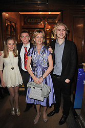 MADELEINE LLOYD WEBBER and her children ALASTAIR LLOYD WEBBER, ISABELLA LLOYD WEBBER and WILLIAM LLOYD WEBBER arrive at the press night of the new Andrew Lloyd Webber  musical 'The Wizard of Oz' at The London Palladium, Argylle Street, London on 1st March 2011 followed by an aftershow party at One Marylebone, London NW1