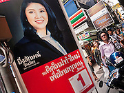 22 JUNE 2011 - BANGKOK, THAILAND: A campaign poster for Yingluck Shinawatra on Silom Rd in Bangkok, Thailand, Wednesday. Yingluck Shinawatra, leader of the Pheua Thai party is running against  incumbent Prime Minister Abhisit Vejjajiva, head of the Democrat party. Yingluck is the youngest sister of exiled former Prime Minister Thaksin Shinawatra, deposed by a military coup in 2006. Yingluck is currently leading in opinion polls, running well ahead of the Democrat party, which in one form or another has ruled Thailand for most of the last 60 years.   Photo by Jack Kurtz