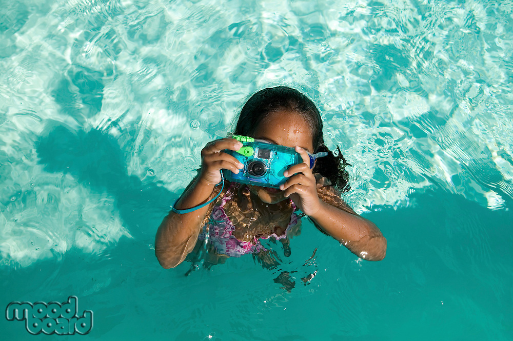 Girl Using Waterproof Camera in Swimming Pool