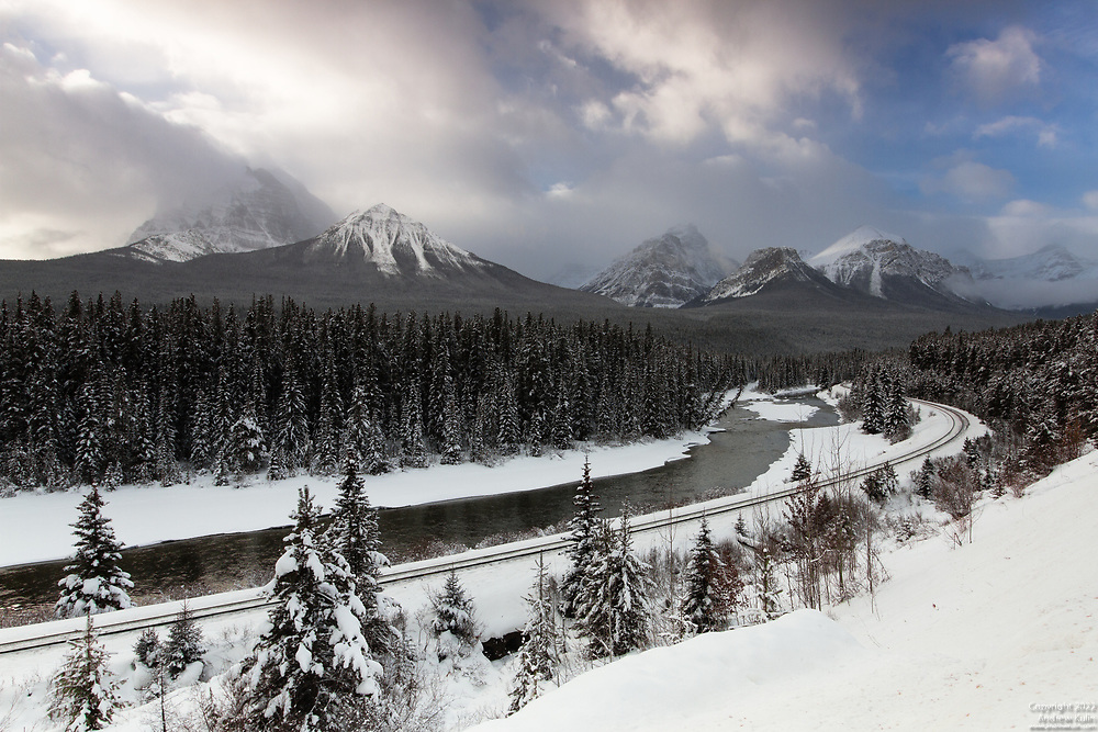 The Canadian Pacific's famous Morant's Curve in the Canadian Rockies as seen on a winter's morning.  Located just east of Lake Louise in Banff National Park, this spot is popular with train spotters who come to see the CPR freight trains or the occasional passenger train on the S-curve with the Bow River and Mount Temple and other mountains in the distance.  I have come here a few times first thing in the morning, while still dark outside to set-up for the sunrise and hopefully catch a train travelling eastbound.  But with no luck with regard to the trains.