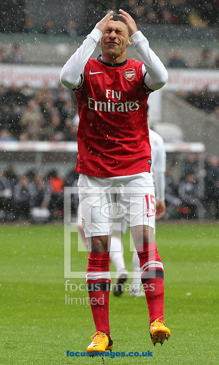 Picture by Mike  Griffiths/Focus Images Ltd +44 7766 223933.16/03/2013.Alex Oxlade-Chamberlain of Arsenal misses one of the best chances of the first half against Swansea City during the Barclays Premier League match at the Liberty Stadium, Swansea.