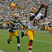 Washington Redskins wide receiver Pierre Garcon reaches to make a catch while being covered by Green Bay Packers cornerback Sam Shields during an NFL football game Sunday, Sept. 15, 2013, in Green Bay, Wis. (AP Photo/Matt Ludtke)
