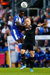Abu Ogogo of Bristol Rovers is challenged by Aaron Mooy of Brighton & Hove Albion - Rogan/JMP - 27/08/2019 - FOOTBALL - Memorial Stadium - Bristol, England - Bristol Rovers v Brighton & Hove Albion - Carabao Cup.
