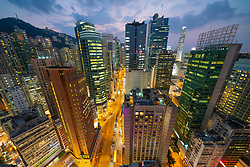 Evening skyline view of high rise towers along Hennessey Road in Wanchai on Hong Kong Island.