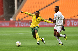 South Africa: Johannesburg: Bafana Bafana player Lebohang Maboe battle for the ball with Seychelles player Benoit Marie during the Africa Cup Of Nations qualifiers at FNB stadium, Gauteng.<br />