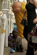 Aisha Yau, 13, tries to get the attention of a Lebanese woman while begging in front of the Al-Ghadir Catering Service and Bakery in Kano. On a good day can earn 1,000 naira (about $7.50) by begging. She hopes to one day become a banker or nurse