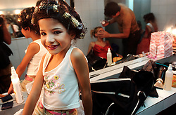A contestant gets her hair and makeup done at  the Miss Mini Universe competition for children ages 6-10.  Venezuela has a deep culture of beauty, fashion and sex appeal. There are dozens of beauty pageants throughout the year for boys and girls of all ages..