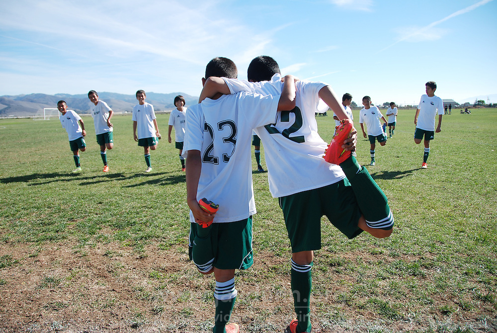"""Members of Real Salinas United, the boy's U-12 team, stretch out at Bolsa Knolls Middle School in Salinas before one of their final tournament games for 2014. The El Camino Real Futbol League is a 501(c)3 non-profit corporation, whose stated mission is """"to provide the youth of Monterey County with the attributes to achieve success in their lives through academic excellence and knowledge of a healthy lifestyle through the game of soccer."""""""