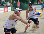 STARE JABLONKI POLAND - July 6: Alexander Horst and Clemens Doppler of Austria in action during Day 5 of the FIVB Beach Volleyball World Championships on July 6, 2013 in Stare Jablonki Poland.  (Photo by Piotr Hawalej)