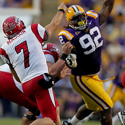 19 September 2009: Louisiana-Lafayette Cajuns quarterback Chris Masson (7) passes as LSU Tigers defensive tackle Drake Nevis (92) pressures on the play during the first half of a game between the University of Louisiana Lafayette Ragin' Cajuns and the  LSU Tigers at Tiger Stadium in Baton Rouge, Louisiana.