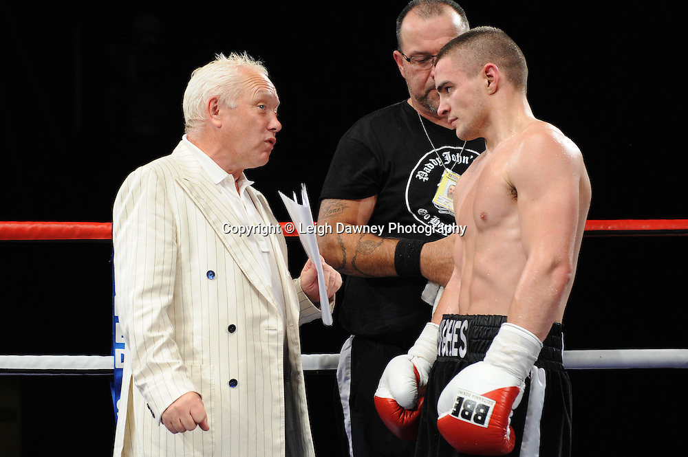 Joe Hughes talking to promoter Frank Maloney after defeating Tony Pace's (in debut fight) in a Light Welterweight contest at the Doncaster Dome, Doncaster, UK, 3rd September 2011. Frank Maloney Promotions. Photo credit: Leigh Dawney 2011