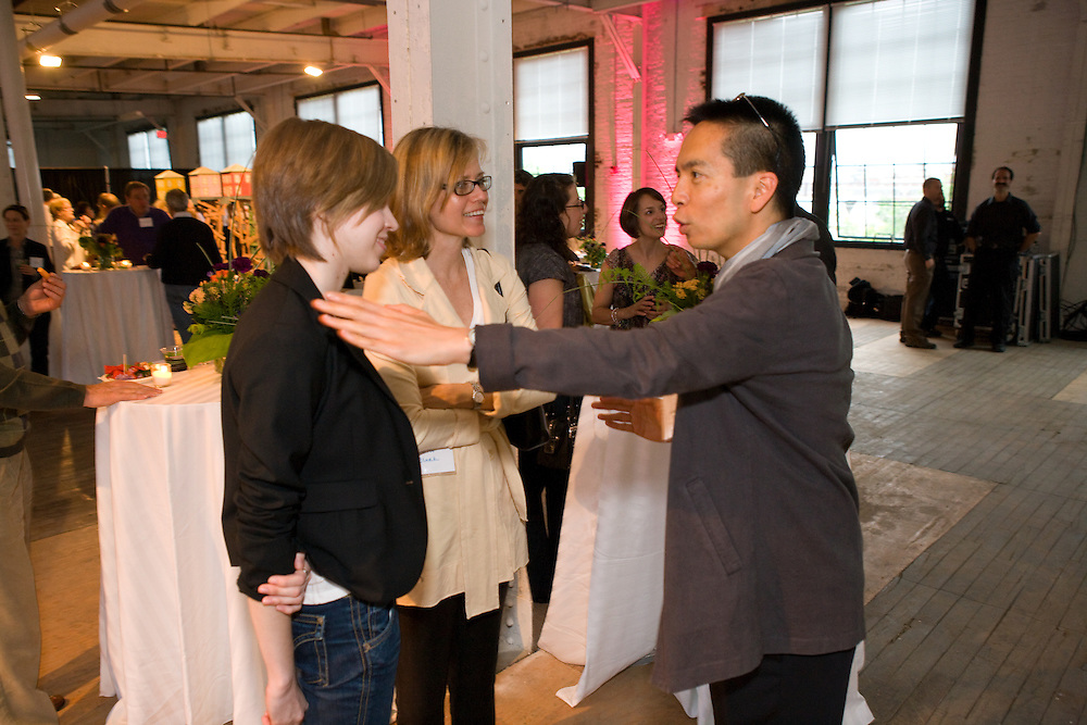 Attendies socialize and meet Rhode Island School of Design's President John Maeda and listen to his presentation to the community.