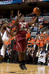 Boston College forward Shamari Spears (34) grabs a rebound from Virginia guard/forward Mamadi Diane (24).  The Virginia Cavaliers men's basketball team defeated the Boston College Golden Eagles 84-66 at the John Paul Jones Arena in Charlottesville, VA on January 19, 2008.