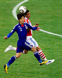 Yuki Abe of Japan vs Lucas Barrios of Paraguay during the 2010 FIFA World Cup South Africa Round of Sixteen football match between Paraguay and Japan on June 29, 2010 at Loftus Versfeld Stadium in Tshwane/Pretoria. (Photo by Vid Ponikvar / Sportida)