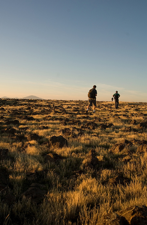 Hikers cross the volcanic tablelands near Jamestown, California, on a late fall afternoon.