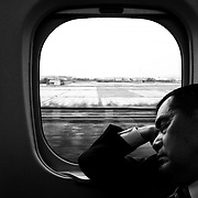 TOKYO, JAPAN - OCTOBER 24 : A man sleeps in a running bullet train on October 24, 2015, Japan.<br />   <br /> Photo: Richard Atrero de Guzman