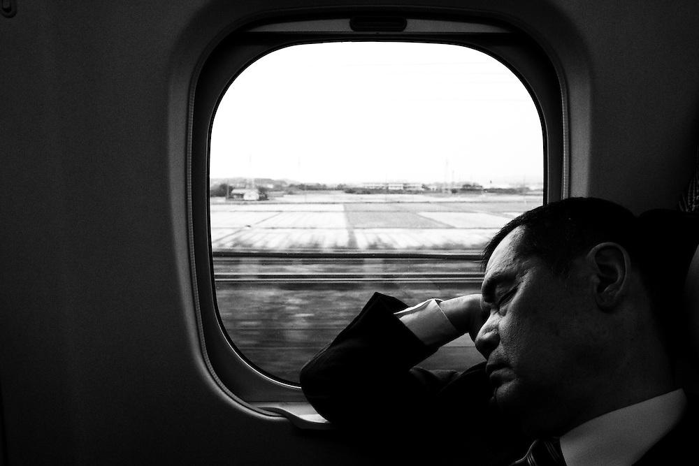 TOKYO, JAPAN - OCTOBER 24 : A man sleeps in a running bullet train on October 24, 2015, Japan.<br />   <br /> Photo: Richard Atrero de Guzman
