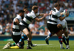 Rhodri Williams of Barbarians is tackled by Piers Francis of England - Mandatory by-line: Ryan Hiscott/JMP - 27/05/2018 - RUGBY - Twickenham Stadium - London, England - England v Barbarians - Quilter Cup