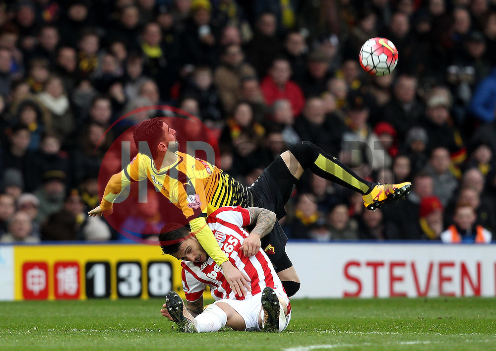 Miguel Britos of Watford and Joselu of Stoke City tangle as they try to win possession of the ball - Mandatory byline: Robbie Stephenson/JMP - 19/03/2016 - FOOTBALL - Vicarage Road - Watford, England - Crystal Palace v Leicester City - Barclays Premier League