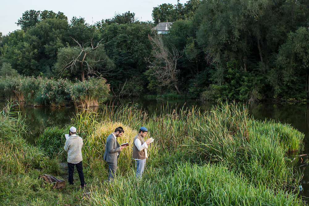 UMAN, UKRAINE - SEPTEMBER 14: Hasidic pilgrims pray along a river, not far from the burial site of Rebbe Nachman of Breslov on September 14, 2015 in Uman, Ukraine. Every year, tens of thousands of Hasidim gather for Rosh Hashanah in the city to pray at the holy site. (Photo by Brendan Hoffman/Getty Images) *** Local Caption ***