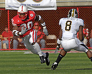 University of Nebraska running back Marlon Lucky (20) rushes past Missouri safety David Overstreet (8) in the second half at Memorial Stadium in Lincoln, Nebraska, November 4, 2006.  The Huskers defeated the Tigers 34-20.<br />