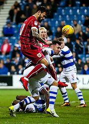 Marlon Pack of Bristol City heads as Grant Hall of Queens Park Rangers challenges - Rogan/JMP - 23/12/2017 - Loftus Road - London, England - Queens Park Rangers v Bristol City - Sky Bet Championship.