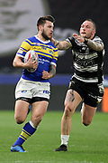 Leeds Rhinos winger Tom Briscoe (2) goes by Hull FC back row forward Dean Hadley (11) during the Betfred Super League match between Hull FC and Leeds Rhinos at Kingston Communications Stadium, Hull, United Kingdom on 19 April 2018. Picture by Mick Atkins.